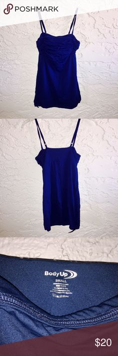 Body Up Empire Waist Tank This top is perfect for yoga, Pilates or barre. Cute enough to be worn out and about. Navy and lightweight, with adjustable straps, ruching across the chest, a flowing loose fit and a cinched tie at the bottom. Body Up Tops Tank Tops