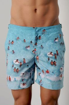 a day at the beach graphic swim trunks