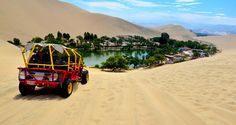 Huacachina is a tiny town in southern Peru, an hour away from the Pacific coast. The town is basically a collection of resorts and restaurants around a blue-green laguna surrounded by huge sand dunes.