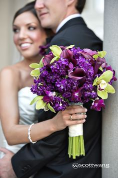 deep purple stock, calla lilies and dendrobium orchids with accents of lime green cymbidiums wedding flower bouquet, bridal bouquet, wedding flowers, add pic source on comment and we will update it. www.myfloweraffair.com can create this beautiful wedding flower look.