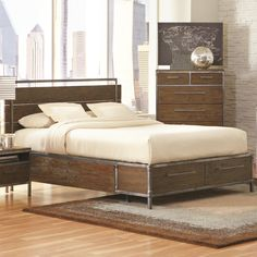 This edgy, industrial bed will be a great focal point for your artsy urban loft or modern bedroom. Subtle knots show through the bed's weathered finish, and modern metal accents are powder coated in a natural pewter finish. You can store your blankets and pajamas in two large drawers at the foot of the bed. This piece's unique character will brighten up any space