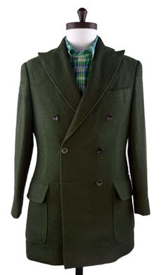 Luxire double breasted Casentino over coat with hip patch pockets.