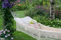 String a white hammock. Got a lot of color in your flower borders? White goes with everything, and a traditional rope hammock is a practical...