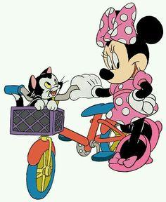 Minnie & Figaro enjoying a bike ride.