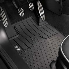 All Weather Floor Mats - If form follows function, we are happy to oblige. These near-indestructible black rubber mats feature vertical grids that funnel moisture to improve footing – ideal for motoring in mud or snow. Meanwhile, a distinctive pattern and MINI logo add a thing or two in the style department. $71.50 Sets of two. http://www.shopminiusa.com/PRODUCT/686/ALL-WEATHER-FLOOR-MATS