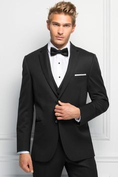 This classic tux from Regal Tuxedo will have your guy looking handsome all day and night! Click the image to learn more. Photo credit: Regal Tuxedo