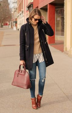 Layer a classic Gap turtleneck over an oxford shirt for a casual and chic outfit. Blogger Penny Pincher Fashion dresses up the look with heeled booties and a statement bag. Shop Gap sweaters and turtlenecks to get the look.
