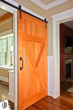 I simply must have a sliding barn door somewhere in my house. Love it!