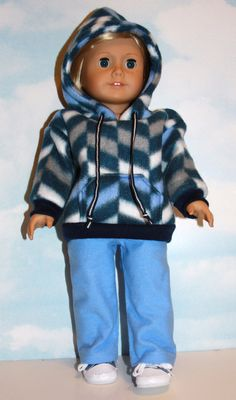 Soft and cozy navy, blue and gray chevron style fleece hoodie has a real working front pocket, navy and white draw cord to secure the hood, and navy rib trim at the sleeves and hem. Simply pulls easily over the dolls head. Light blue flannel pajama pants have an easy pull-on elastic waist. Velcro-free dressing!  This outfit would work for either a boy or girl doll.  Made by me in my smoke-free, pet-friendly home using a Flossie Potter pattern. I am a Liberty Jane Partner. All seams are…