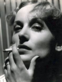 Carole Lombard - Late 1930s - And this is why smoking is so attractive.
