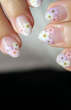 Love the cute flowers! Needs a different shape to the nails though. Square them off.