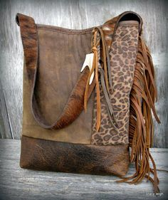 Distressed Leather Fringe Bucket Bag with Leopard Print and Deer Antler by Stacy Leigh One of a kind, leather shoulder bag made from very distressed,