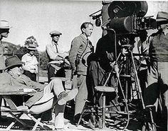 """Director John Ford (in chair, far left, on the """"Stagecoach"""" set) did not direct """"Stagecoach"""" for 20th Century-Fox, but for United Artists under producer Walter Wanger."""