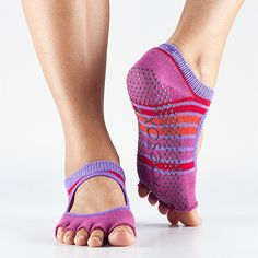 Yoga Gear You Need | ToeSox Bella Half Toe Grip: These socks contain some hidden design gems, including an arch support band and a fitted heel to keep it from bunching or twisting out of place. The keyhole face and half toe design also keep your feet from needing a miniature sweat fan. ToeSox also makes a half knee sock for chillier settings that you can scrunch Flashdancer style or wear high à la Napolean Dynamite. ToeSox.com, $16.