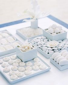 White sweets: white chocolate candy, white rock candy, truffles, chocolate filled white dragees, marshmallows, and candied coconut