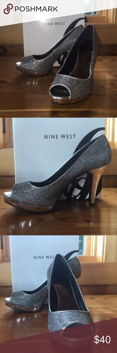 Nine West peep toe metallic silver pump Nine West peep toe metallic silver pump. Look like glitter but made material. Shiny platform and heel. Like new worn once to a wedding. Heel approx 4 inches. Original box Nine West Shoes Heels