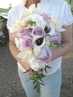 lavender Roses, Picasso Calla Lilies, Freesia and Cymbidium Orchids in the classic cascading style