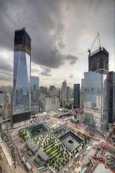 WTC Memorial and New Buildings Honoring The Victims following the collapse of #WorldTradeCenter Twin Towers (Two of the 4 Targets of #911) Remembering and Honoring the Heroes of 9-11-2001 9-11 #NeverForget #911 #Remembering911 9/11/2001