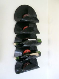 Wine Rack Made From Upcycled Vinyl Records - you can almost always find vinyl records at Goodwill. www.goodwillvalleys.com/shop/