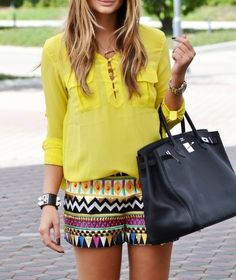 Loving this yellow shirt with the Aztec print shorts.