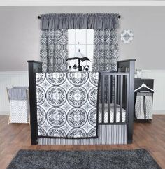 Medallions Crib Bedding  These sophisticated filigree medallions perfectly   stylize your baby's nursery. The Medallions Crib   Bedding Set features spectacular filigree   medallions, variegated stripes and mini   starbursts printed on cozy fabric. The classic   color palette of black and white with shades of   cool gray brings the perfect blend of style and   sophistication to the nursery.