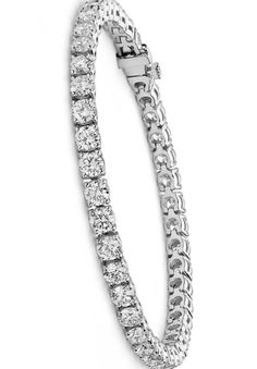 Flash some brilliance with this breathtaking 10 carat tennis bracelet, showcasing dazzling round diamonds prong-set in complementing 18k white gold.