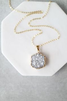 "Up your long necklace game with this Druzy hex pendant. Details: 28"" Lobster clasp closure Gold plated metal chain"