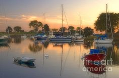 $24.00  Sunset on Southport Harbor in Southport, Connecticut with Sailboats and reflections on the water.