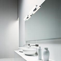 NORMA Famiglia di applique, LED e alogene, a luce diffusa, caratterizzate da un tubo diffusore in Pyrex sabbiato o in metacrilato opalino (LED) montato su una struttura in alluminio spazzolato lucido.