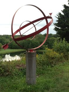 Roseview Dressage Armillary- made from the rims of wagon wheels mounted on a concrete base textured with bamboo stakes and burlap. Roseview Dressage, Millbrook, NY. http://pinterest.com/RosevieDressage/
