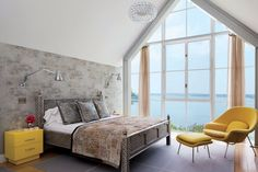 bedroom design 22 Flawless Contemporary Bedroom Designs Beautiful bedroom design in grey and yellow by Mchael Haverland Architect