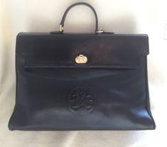 Vintage FENDI handbag classic Kelly style with Janus medaillon embossed at front in black von CarlaDiVolpe auf Etsy