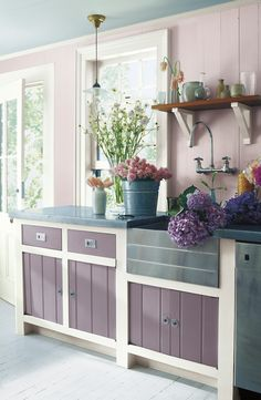 A farmhouse kitchen with Ralph Lauren Paint colors inspired by fresh-cut flowers. Duchess Lilac on the walls and Kensington Purple on the cabinets.