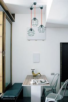 Industrial lights hang from the ceiling, above the nondescript table that is great for serving meals. But it is not just any table, it is space-saving because it can be folded up when not in use.