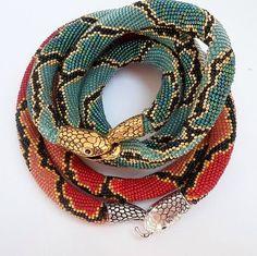 Красная змейка и другие...I'm not a fan of snakes, but the detail and workmanship in these bracelets is unbelievable!: