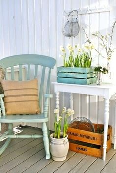 Old table, rocker and crate sets a cute shabby chic feel.