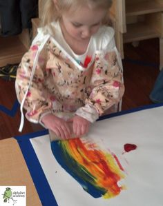 """Rolling"" art — spoon primary color paint on paper, and let friends roll a toilet paper tube over the paint!"