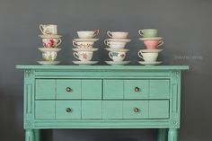 Gorgeous idea; colours, stacking cups & saucers & rustic re-painted furniture