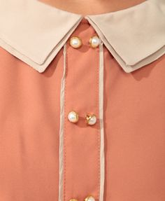 Loving the double button/collar detail.
