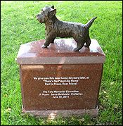 """This is Toto, Dorothy's beloved dog from the 1939 classic """"The Wizard of Oz"""".    Toto (whose real name was 'Terry') was a Scottish Cairn Terrier, who went on to appear in more than a dozen films.    Toto isn't actually buried here.  His original grave was destroyed by freeway construction.  So, in 2011, Hollywood Forever has honored him with this little monument. The words on the pedestal read """"There's No Place Like Home."""""""
