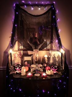 Samhain altar the material and purple lights, but NOT the horned skull! Altar Decorations, Halloween Decorations, Wicca Altar, Wiccan Decor, Wiccan Art, Suncatcher, Samhain Halloween, Goth Home, Beltane