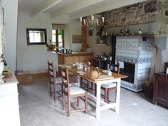 The Kitchen After - Walls insulated with organic hemp plaster, floor with lime plaster. Recuperated wood used to make table, chairs salvaged from the tip/dump, recuperated windows.