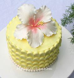 "Hibiscus cake~ From a video tutorial on MyCakeSchool.com.  (Buttercream vertical ""petal effect"" around sides)"
