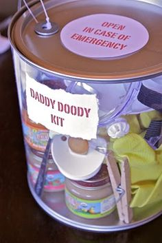 "Cute gift idea to include the Dad-to-be at a Baby Shower.  ""Emergency Daddy Kit"" ( Good idea, the dad's rarely get gifts!)"