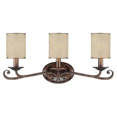 Add a touch of elegance to your powder room or master bath with this scrolling vanity light, showcasing a rustic finish and crisp cylinder shades. ...