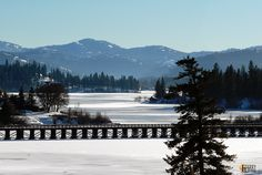 Beautiful sunny view of Curlew Lake, WA, and the old railroad trestle (which has been converted to a rails-to-trails).  Located in Eastern Washington State, the lake is typically frozen over by the end of December, and will likely remain so through the end of March. Rainbow Trout, Washington State, Places To Go, Trail, December, Frozen, Old Things, History, Outdoor