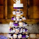 purple and white cupcake wedding cake with simple topper