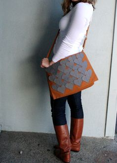 orange messenger bag with grey hearts
