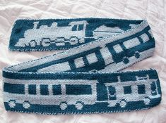 Free Knitting Pattern for Train Scarf - Double knit scarf with train motifs that can be used with other projects such as afghans, sweaters, and more. Chugga Chugga designed by Laura Chamberlain. Pictured project by rnmpinky