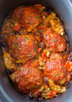 Slow Cooker Mediterranean Chicken with artichoke hearts, olives and roasted red peppers in a briny, herby tomato sauce is tender and flavorful with just five minutes of prep work!
